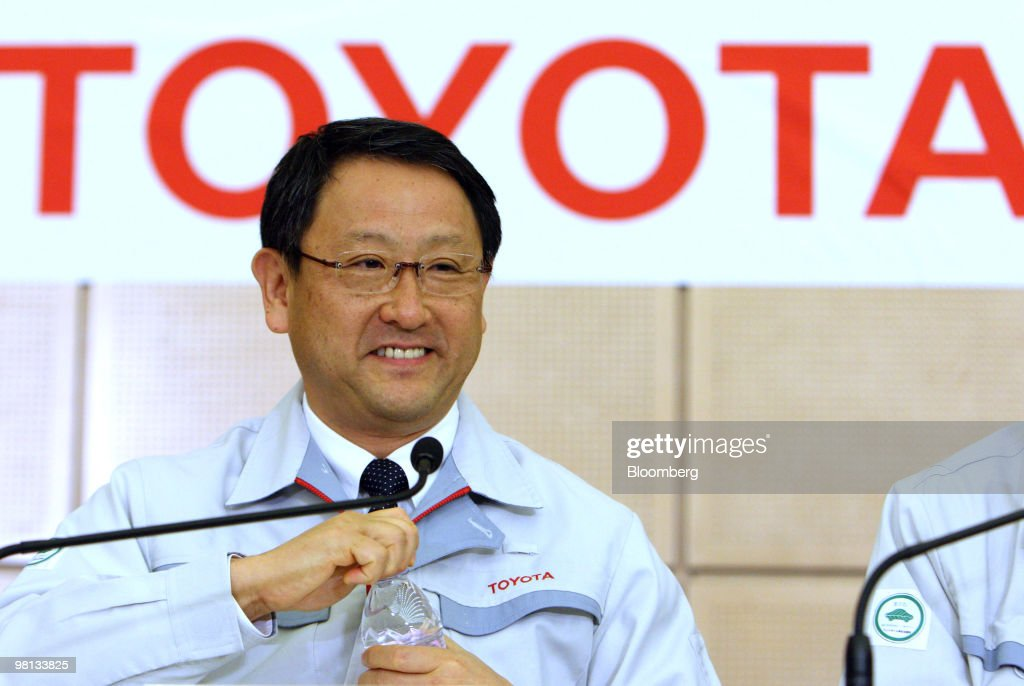 Akio Toyoda, president of Toyota Motor Corp., smiles as he opens a bottle of water during a news conference after the first meeting of the Special Committee for Global Quality in Toyota City, Japan, on Tuesday, March 30, 2010. Toyota Motor Corp.'s accelerator flaws and electronic vehicle controls will be examined by NASA as the U.S. expands its probe into incidents linked to at least 51 deaths. Photographer: Tomohiro Ohsumi/Bloomberg via Getty Images