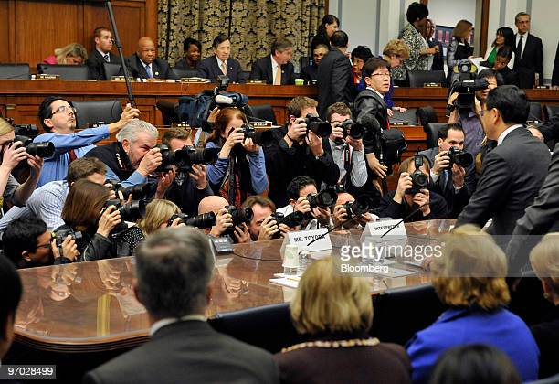 Akio Toyoda president of Toyota Motor Corp standing at right arrives to testify at a House Oversight and Government Reform Committee hearing in...