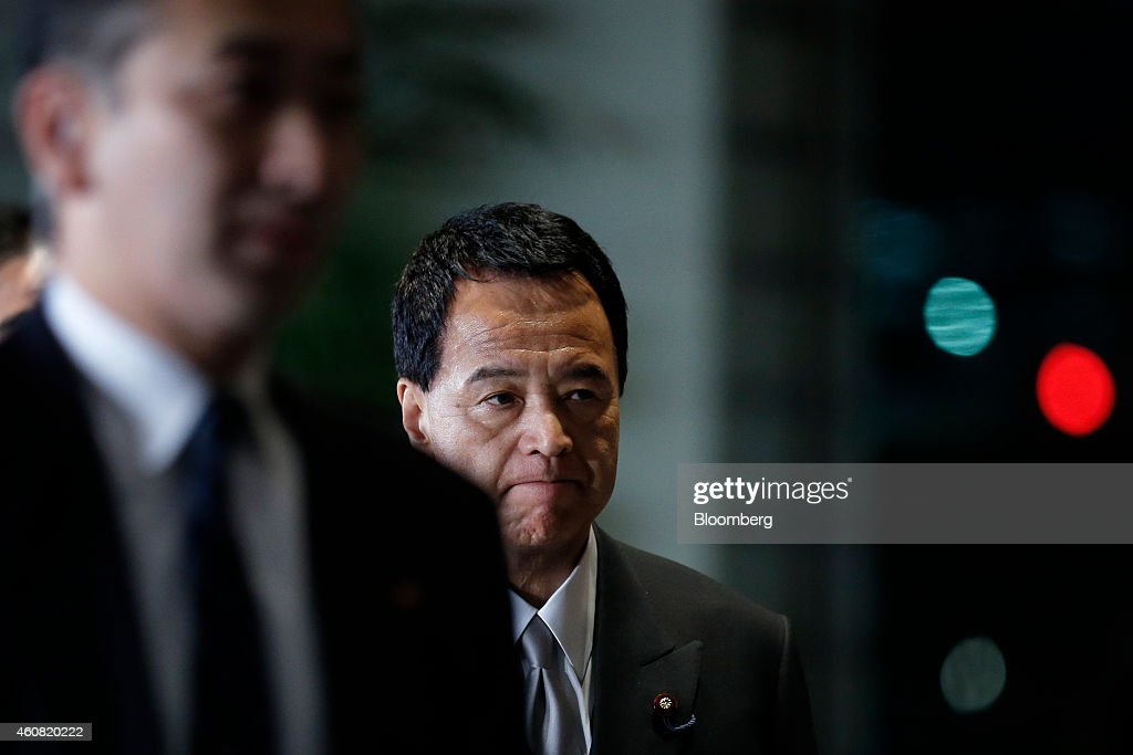 Akira Amari, Japan's re-appointed economic revitalization minister, arrives at the prime minister's official residence after the attestation ceremony at the Imperial Palace in Tokyo, Japan, on Wednesday, Dec. 24, 2014. Japanese Prime Minister Shinzo Abe appointed a former soldier and security veteran as his new defense minister, as he prepares to push through legislation to toughen the countrys military stance amid a dispute with China. Photographer: Kiyoshi Ota/Bloomberg via Getty Images