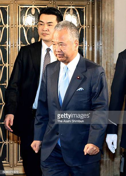 Akira Amari the minister in charge of economic revitalization is seen on arrival to an Upper House Audit Committee session at the diet building on...