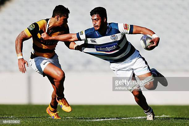 Akira Ioane of Auckland fends off Sean Wainui of Taranaki during the round two ITM Cup match between Auckland and Taranaki at Eden Park on August 23...