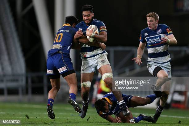 Akira Ioane of Auckland is tackled by Josh Ioane of Otago during the round six Mitre 10 Cup match between Otago and Auckland at Forsyth Barr Stadium...