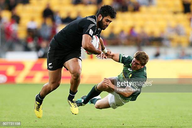Akira Ioane of New Zealand fends Kwagga Smith of South Africa during the 2016 Wellington Sevens cup final match between New Zealand and South Africa...
