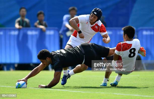 Akira Ioane of New Zeland dives over for a try during the Men's Rugby Sevens Pool C match between New Zealand and Japan on Day 4 of the Rio 2016...