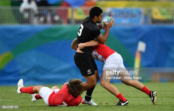 Akira Ioane of New Zeland is tackled by Dan Bibby of Great Britain and James Davies of Great Britain during the Men's Rugby Sevens Pool C match...