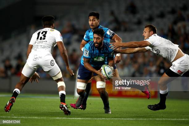 Akira Ioane of the Blues is tackld during the round sevens Super Rugby match between the Blues and the Sharks at Eden park on March 31 2018 in...