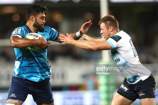 Akira Ioane of the Blues is tackled by Cam Clark of the Waratahs during the round 8 Super Rugby match between the Blues and Waratahs at Eden Park on...