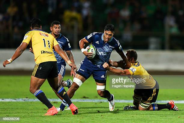 Akira Ioane of the Blues is tackled by James Broadhurst of the Hurricanes during the round five Super Rugby match between the Hurricanes and the...