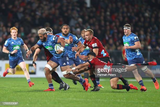 Akira Ioane of the Blues is tackled by Richie Mo'unga of the Crusaders during the round 5 Super Rugby Aotearoa match between the Crusaders and the...