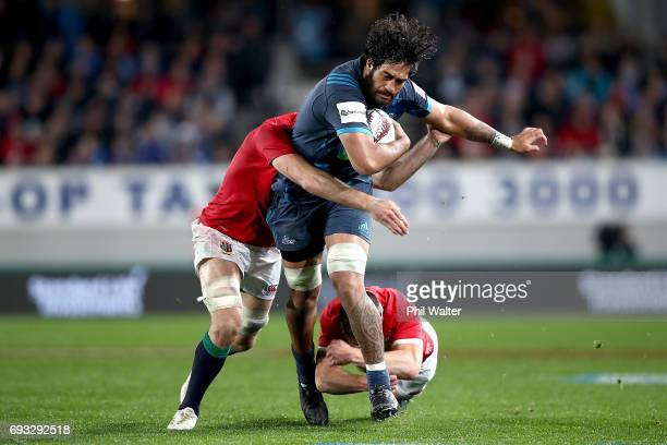 Akira Ioane of the Blues is tackled during the match between the Auckland Blues and the British Irish Lions at Eden Park on June 7 2017 in Auckland...