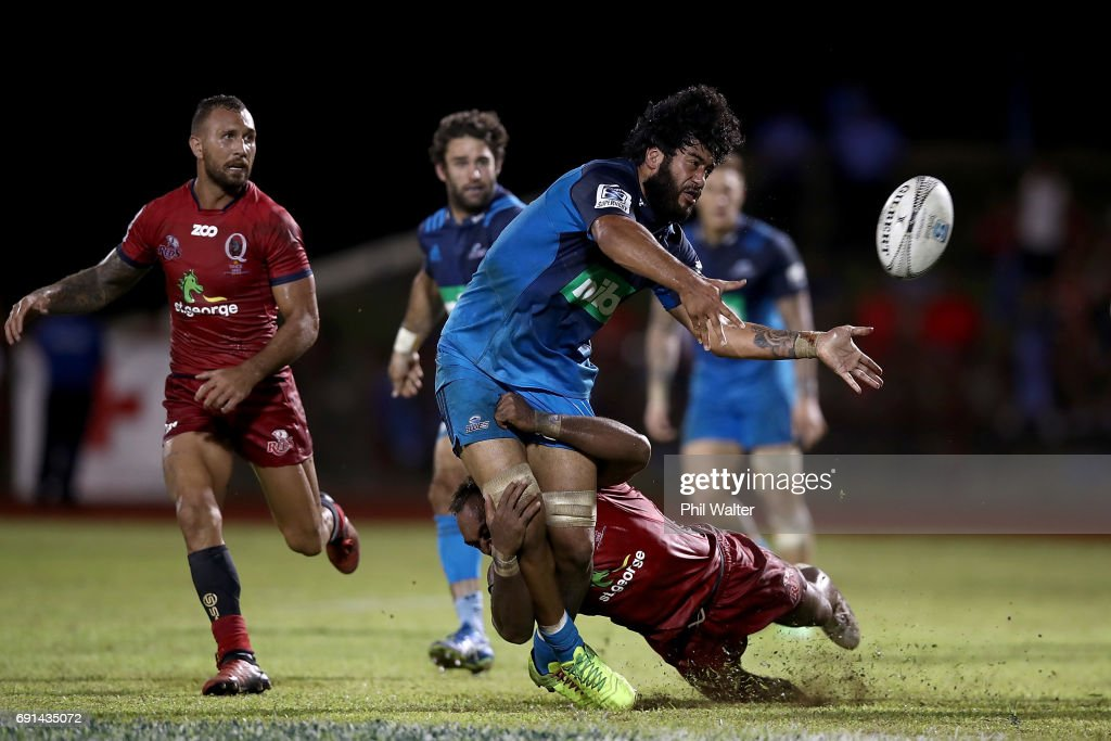 Akira Ioane of the Blues is tackled during the round 15 Super Rugby match between the Blues and the Reds at Apia Park National Stadium on June 2, 2017 in Apia, Samoa.