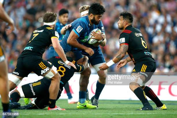 Akira Ioane of the Blues is tackled during the round two Super Rugby match between the Chiefs and the Blues at Rugby Park on March 3 2017 in Hamilton...