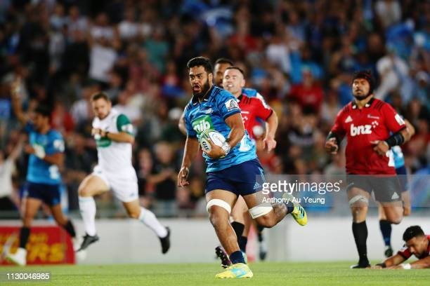 Akira Ioane of the Blues makes a break on his way to score a try during the round 1 Super Rugby match between the Blues and the Crusaders at Eden...