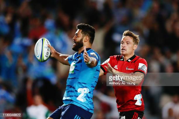 Akira Ioane of the Blues scores a try against George Bridge of the Crusaders during the round 1 Super Rugby match between the Blues and the Crusaders...