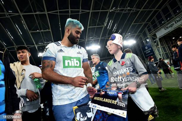 Akira Ioane of the Blues signs autographs following the round eight Super Rugby Aotearoa match between the Highlanders and the Blues at Forsyth Barr...
