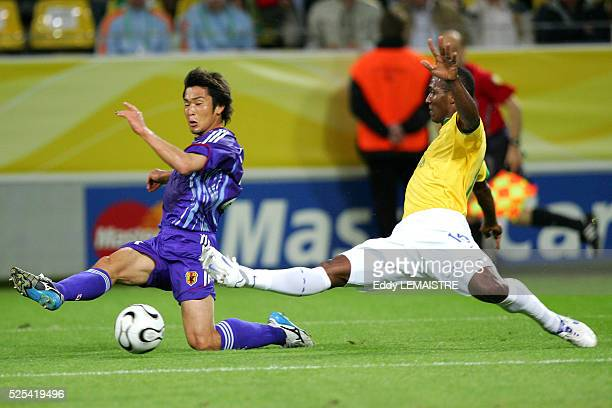 Akira Kaji and Gilberto during the 2006 FIFA World Cup match between Japan and Brazil in Dortmund Germany