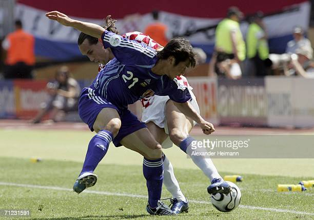 Akira Kaji of Japan battles for the ball with Dado Prso of Croatia during the FIFA World Cup Germany 2006 Group F match between Japan and Croatia at...