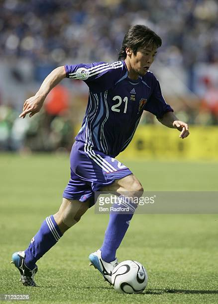 Akira Kaji of Japan runs with the ball during the FIFA World Cup Germany 2006 Group F match between Japan and Croatia at the Frankenstadion on June...