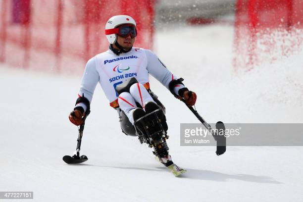 Akira Kano of Japan competes in Mens Downhill Sitting during day one of Sochi 2014 Paralympic Winter Games at Rosa Khutor Alpine Center on March 8...