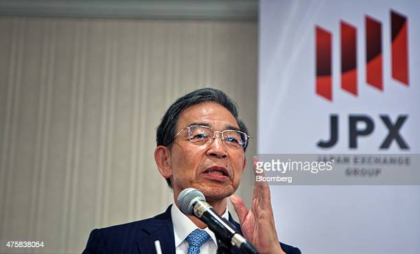 Akira Kiyota president of Tokyo Stock Exchange Inc gestures as he speaks at the opening of the Singapore branch of the Tokyo Stock Exchange Inc and...