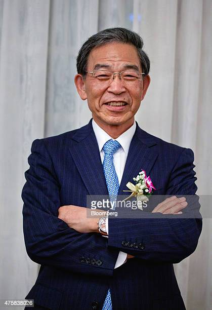 Akira Kiyota president of Tokyo Stock Exchange Inc poses for a photograph at the opening of the Singapore branch of the Tokyo Stock Exchange Inc and...
