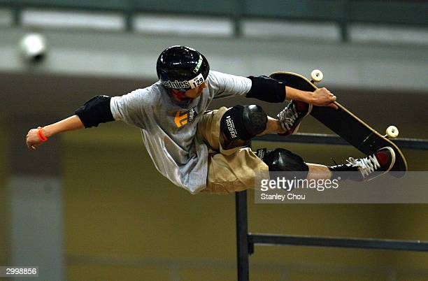 Akira Kubota of Japan in action during the Skateboarding Vert preliminary round at the Asian XGames finals February 20 2004 held at the Bukit Jalil...