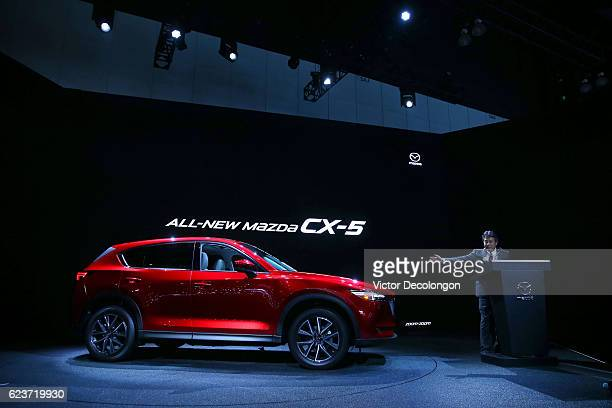 Akira Marumoto Executive Vice President of Mazda speaks onstage at the Mazda press conference event at the LA Auto Show on November 16 2016 in Los...