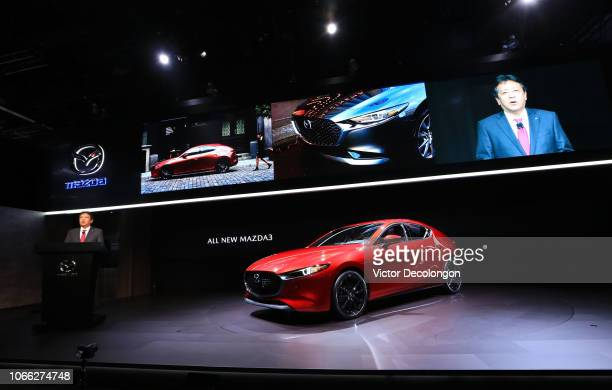 Akira Marumoto President and CEO Mazda Motor Corporation speaks onstage during the LA Auto Show on November 28 2018 in Los Angeles California
