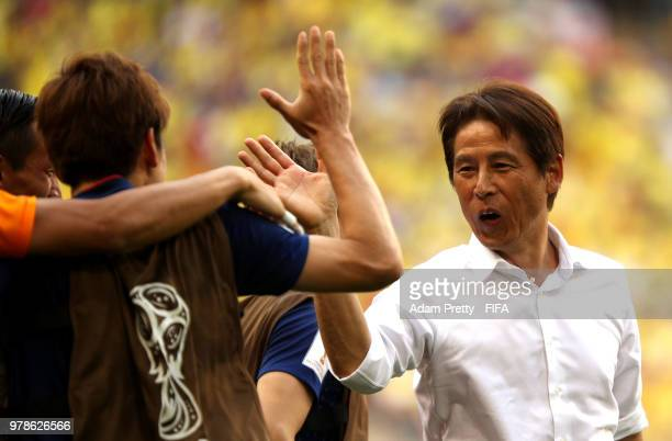 Akira Nishino Manager of Japan celebrates with his team following his sides victory in the 2018 FIFA World Cup Russia group H match between Colombia...