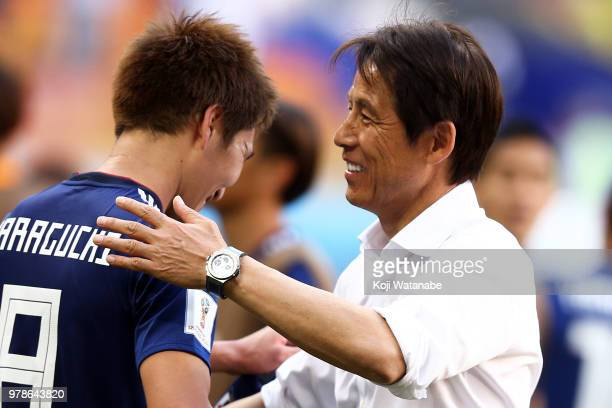 Akira Nishino Manager of Japan celebrates with his team following his sides victory during the 2018 FIFA World Cup Russia group H match between...