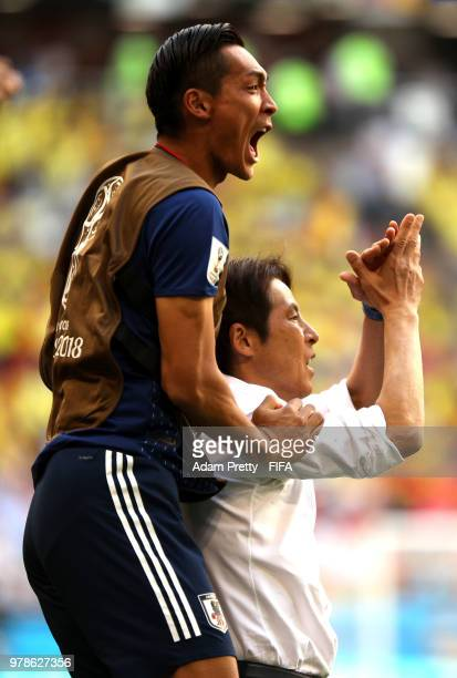 Akira Nishino Manager of Japan celebrates with Tomoaki Makino of Japan following their sides victory in the 2018 FIFA World Cup Russia group H match...