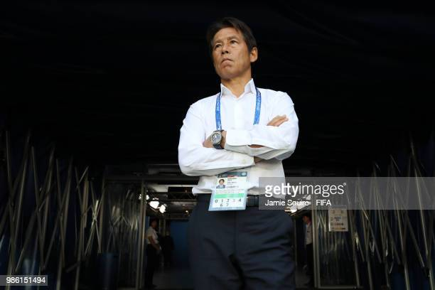 Akira Nishino Manager of Japan look on prior to the 2018 FIFA World Cup Russia group H match between Japan and Poland at Volgograd Arena on June 28...
