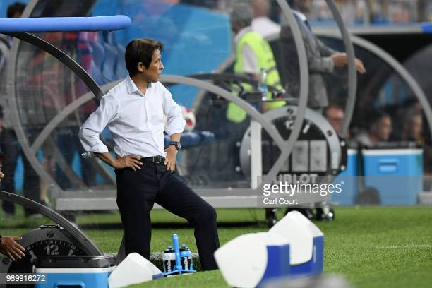 Akira Nishino Manager of Japan looks on during the 2018 FIFA World Cup Russia Round of 16 match between Belgium and Japan at Rostov Arena on July 2...