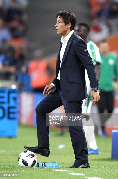 Akira Nishino Manager of Japan puits his foot on the ball during the 2018 FIFA World Cup Russia group H match between Japan and Senegal at...