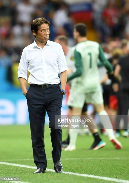Akira Nishino Manager of Japan stands dejected following the 2018 FIFA World Cup Russia Round of 16 match between Belgium and Japan at Rostov Arena...