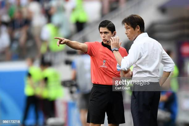Akira Nishino Manager of Japan talk to the fourth official Ricardo Montero during the 2018 FIFA World Cup Russia group H match between Japan and...