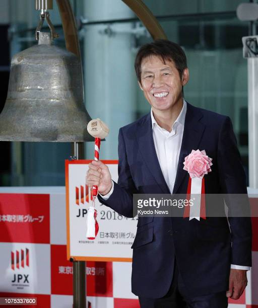 Akira Nishino who coached Japan's 2018 World Cup football team poses for a photo in front of the bell at the Tokyo Stock Exchange on Dec 28 the last...