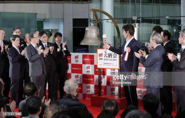 Akira Nishino who coached Japan's 2018 World Cup football team rings the bell at the Tokyo Stock Exchange on Dec 28 the last trading day of the year...