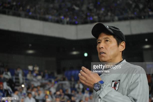 Akira Nishinocoach of Japan looks on after the international friendly match between Japan and Ghana at Nissan Stadium on May 30 2018 in Yokohama...