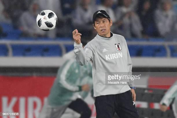 Akira Nishinocoach of Japan looks on during the international friendly match between Japan and Ghana at Nissan Stadium on May 30 2018 in Yokohama...