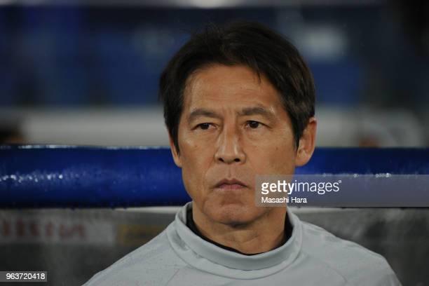 Akira Nishinocoach of Japan looks on prior to the international friendly match between Japan and Ghana at Nissan Stadium on May 30 2018 in Yokohama...