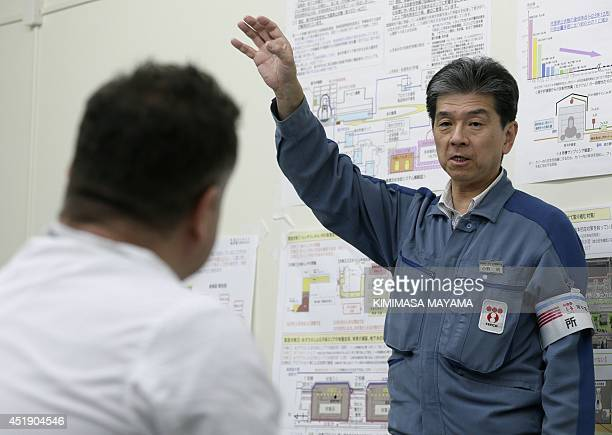 Akira Ono plant chief for the tsunamicrippled Tokyo Electric Power Co's Fukushima Daiichi nuclear power plant gestures as he explains the...