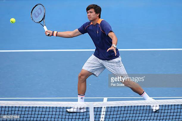 Akira Santillan of Australia in action in his match against Duck Hee Lee of Korea during the Australian Open 2015 Junior Championships at Melbourne...
