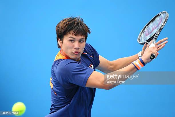 Akira Santillan of Australia in action in his match against Nam Hoang Ly of Vietnam during the Australian Open 2015 Junior Championships at Melbourne...