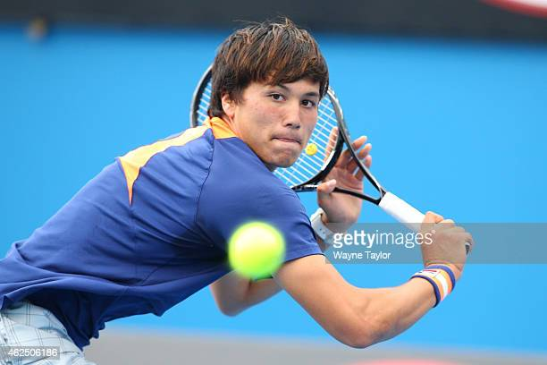 Akira Santillan of Australia in action in his semifinal match against Seongchan Hong of Korea during the Australian Open 2015 Junior Championships at...