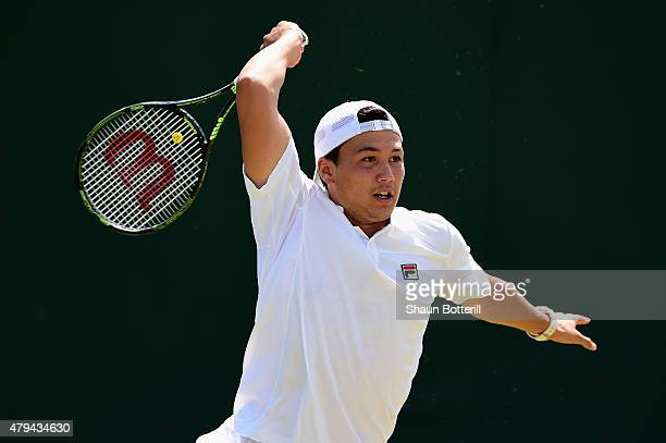 Akira Santillan of Japan in action during the Boys Singles First Round match against Manuel PenaLopez of Argentina during day six of the Wimbledon...