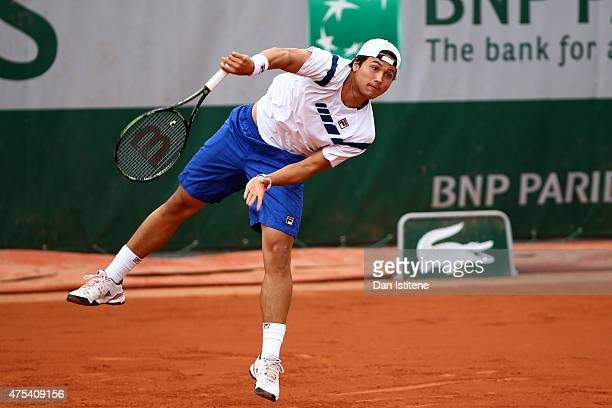 Akira Santillan of Japan serves during his boys' singles match against Alex Molcan of Slovakia on day eight of the 2015 French Open at Roland Garros...