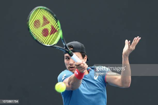 Akira Santillan plays a forehand in his match against Jacob Grills during the 2019 Australian Open Playoff match at Melbourne Park on December 10...