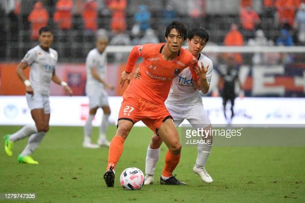Akira TOSHIMA of Omiya Ardija and Yuki NISHIYA of Tochigi SC battle for the ball during the J.League Meiji Yasuda J2 match between Omiya Ardija and...