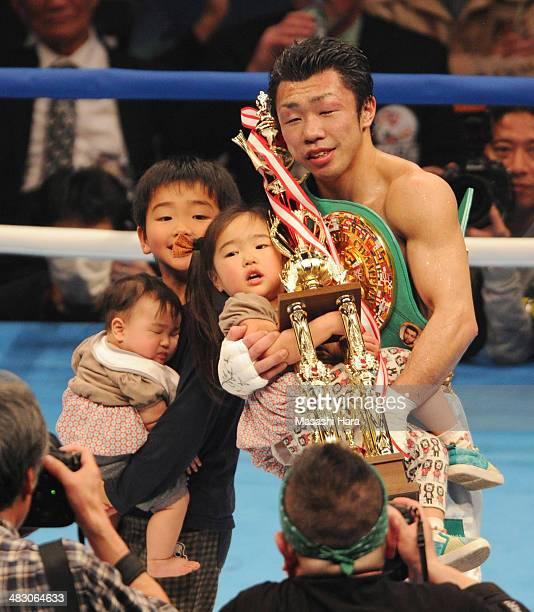 Akira Yaegashi celebrates the victory with his family after the WBC flyweight title bout between Akira Yaegashi of Japan and Odilon Zaleta of Mexico...
